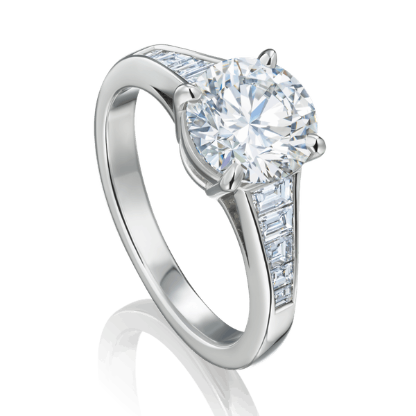Diamond Engagement Ring With Graduated Trapezium Cut Diamond Shoulders