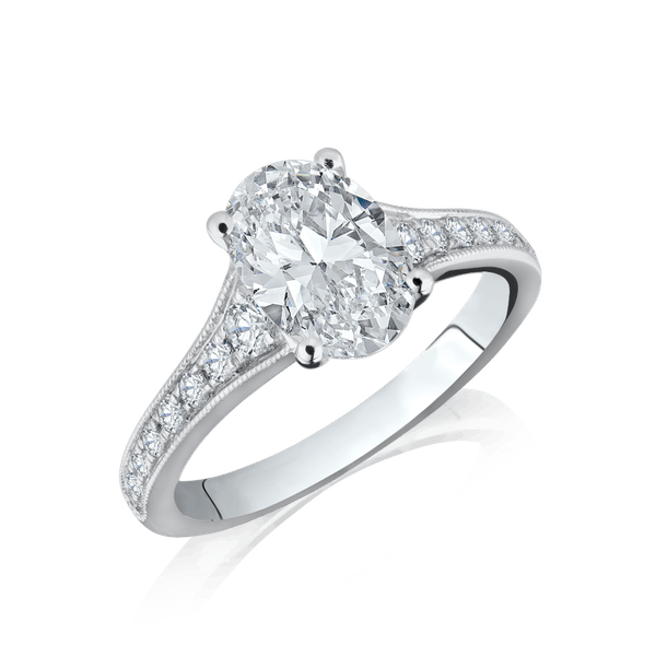 Oval Diamond Engagement Ring With Graduated Diamond Set Shoulders