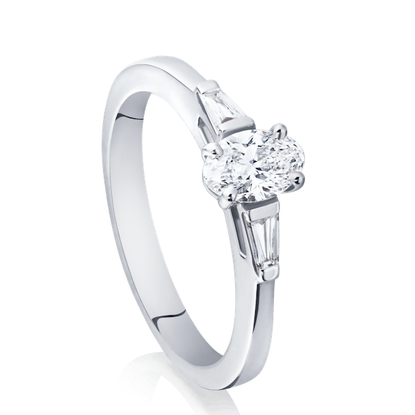 Oval Diamond Engagement Ring With Tapering Baguette Cut Shoulders